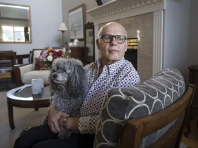 Max Morton, 81, sits with his dog Barney at his home in Richmond, B.C., on Monday October 30, 2017. Morton is one of 411 patients who had transcatheter aortic valve replacement surgery where the damaged aortic valve is replaced without removing the old one. The procedure is an alternative to the more invasive open-heart surgery. THE CANADIAN PRESS/Darryl Dyck