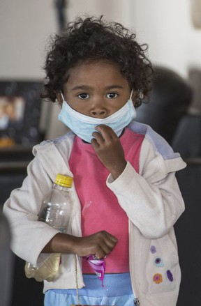A child wears a face mask at a school in Antananarivo, Madagascar, Tuesday, Oct. 3, 2017. Authorities in Madagascar are struggling to contain an outbreak of plague that has killed at least two dozen people, and the government has begun a campaign to disinfect school classrooms in the city. (AP Photo/Alexander Joe)