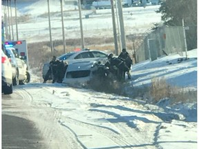 A crash in Nisku that ended with several naked people in police custody began with a kidnapping, RCMP said Tuesday.