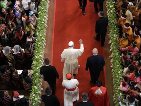 Pope Francis, center, arrives to celebrate a Mass with young people in St. Mary's Cathedral in Yangon, Myanmar, Thursday, Nov. 30, 2017. Francis is wrapping up his visit to Myanmar with a Mass for young people before heading to neighboring Bangladesh where the Rohingya Muslim refugee crisis is expected to take center stage. (AP Photo/Andrew Medichini)
