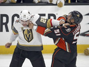 Vegas Golden Knights left winger William Carrier (28) and Anaheim Ducks left winger Mike Liambas (51) fight in the first period of an NHL hockey game in Anaheim, Calif., Wednesday, Nov. 22, 2017. (AP Photo/Reed Saxon)