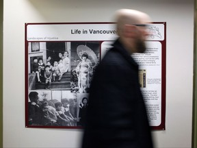 UVic historian Jordan Stanger-Ross is leading Landscapes of Injustice, a research project in the field of humanities in Canada about the letters of outrage reflecting injustices towards Japanese Canadians as he walks by Landscape of Injustice sign in the Sedgwick Building at the University of Victoria in Victoria, B.C., on Tuesday, November 7, 2017. THE CANADIAN PRESS/Chad Hipolito