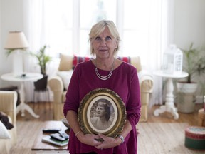 Alison Steel holds a photo of her mom, Jean Steel, in her home in Knowlton, Quebec November 10, 2017.