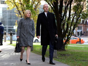 Laura Miller, former deputy chief of staff to ex-Ontario premier Dalton McGuinty, arrives at court in Toronto with her lawyer Scott Hutchison on Tuesday, Nov. 7, 2017. Miller and her boss, David Livingston, have pleaded not guilty to charges of illegally destroying documents related to the Liberal government???s controversial 2011 gas plants cancellations. THE CANADIAN PRESS/Colin Perkel