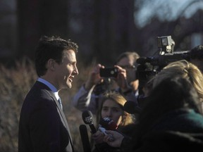 "A lawyer for members of the military and other federal agencies who were investigated, sanctioned and fired because of their sexual orientation says a ""fair and reasonable settlement"" has been reached with the government. Prime Minister Justin Trudeau takes questions from the media outside the Confederation Centre of the Arts in Charlottetown, P.E.I., on Thursday, Nov 23, 2017. THE CANADIAN PRESS/Nathan Rochford"