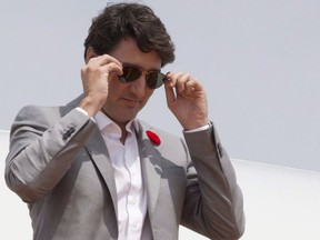 Canadian Prime Minister Justin Trudeau removes his sunglasses as he arrives in Ho Chi Minh City, Vietnam on Thursday November 9, 2017. Trudeau is sporting P.E.I. made sunglasses from Fellow Earthlings eyewear. THE CANADIAN PRESS/Adrian Wyld