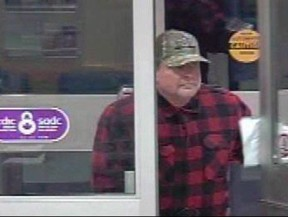 A suspect is shown in a screengrab from video in a handout from the Medicine Hat Police Service Facebook page. Saskatoon police have charged a former Winnipeg television news director in a bank robbery that occurred in July.Stephen Vogelsang, who is 53, is currently in custody in Medicine Hat, Alta., charged with robbing two banks in that city. THE CANADIAN PRESS/HO-Facebook-Medicine Hat Police Service MANDATORY CREDIT