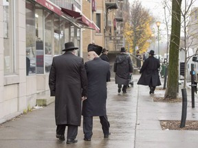 Hasidic Jewish men walk along Bernard Street in Outremont, in Montreal on Wednesday, November 16, 2016. The size of the country's Jewish community appears, on the surface, to have seen its most dramatic decline in decades, with newly released census data on the country's ethnic makeup suggesting a 56 per cent drop in numbers over a five-year period. THE CANADIAN PRESS/Ryan Remiorz