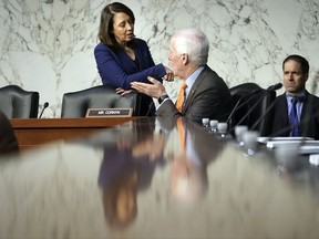 Sen. Maria Cantwell, D-Wash., and Sen. John Cornyn, R-Texas, talk before the start of panel of the Senate Finance Committee begins work on overhauling the nation's tax code, on Capitol Hill in Washington, Monday, Nov. 13, 2017. The legislation in the House and Senate carries high political stakes for President Donald Trump and Republican leaders in Congress, who view passage of tax cuts as critical to the GOP's success at the polls next year. (AP Photo/Pablo Martinez Monsivais)