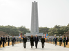U.S. President Donald Trump and first lady Melania Trump walk to lay a wreath at the South Korean National Cemetery, Wednesday, Nov. 8, 2017, in Seoul, South Korea.