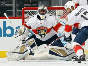Roberto Luongo of the Florida Panthers became the second goalie in NHL history with 200 wins for two different teams when the Panthers beat New Jersey 3-2 on Monday.
