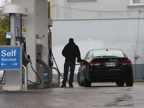 In this November 5 photo, a Torontonian fills up with some very, very expensive fuel.