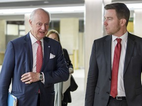 UN Special Envoy of the Secretary-General for Syria Staffan de Mistura, left, arrives prior to a round of negotiation, during the Intra Syria talks, at the European headquarters of the United Nations in Geneva, Switzerland, Wednesday, Nov. 29, 2017. (Martial Trezzini/Keystone via AP)