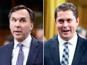Finance Minister Bill Morneau, left, and Conservative Leader Andrew Scheer spar during question period on Wednesday.
