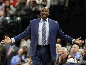 Indiana Pacers coach Nate McMillan questions a call during the first half of the team's NBA basketball game against the New Orleans Pelicans in Indianapolis, Tuesday, Nov. 7, 2017. (AP Photo/Michael Conroy)