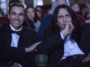 """This image released by A24 shows Dave Franco, left, and James Franco in a scene from """"The Disaster Artist."""" (Justina Mintz/A24 via AP)"""