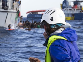 A migrant's hand is seen as member of a German nonprofit organisation looks at other migrants trying to board a Libyan coast guard ship after being rescued at sea, Monday, Nov. 6, 2017. Five migrants have died as a German nonprofit organization, Sea-Watch, and the Libyan coast guard tried to rescue them from their foundering boat in the Mediterranean, with each side blaming the other for botching the operation. (Lisa Hoffmann/Sea-Watch via AP)