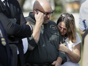 Pastor Frank Pomeroy and his wife Sherri join a news conference near the First Baptist Church of Sutherland Springs, Monday, Nov. 6, 2017, in Sutherland Springs, Texas. A man opened fire inside the church in the small South Texas community on Sunday, killing more than two dozens and injuring others. The Pomeroy's daugher, Annabelle, 14, was killed in the shooting. (AP Photo/Eric Gay)