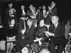 FILE - In this Nov. 21, 1963, file photo first lady Jackie Kennedy, President John F. Kennedy, Lady Bird and Vice President Lyndon Johnson attend a LULAC dinner in Houston. Newly released documents regarding John F. Kennedy's assassination show the FBI was monitoring Latino civil rights groups weeks before the president would make history by visiting with one of the organizations. A memo released October 2017 said an FBI informant kept close watch on a Dallas chapter of the G.I. Forum, a moderate group of Mexican American veterans who spoke out against discrimination. (Ted Rozumaiski/Houston Chronicle via AP, File)