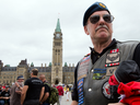 Veterans and their supporters protest on Parliament Hill against their treatment by Stephen Harper's government in June 2014. The Trudeau government is hoping to avoid more scenes like this.