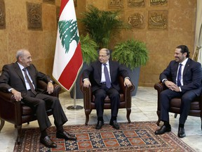 In this photo released by the Lebanese Government, Lebanese President Michel Aoun, center, meets with Prime Minister Saad Hariri, right, and Parliament Speaker Nabih Berri, left, at the Presidential Palace in Baabda, east of Beirut, Lebanon, Monday, Nov. 27, 2017. Aoun launched consultations with the country's political leaders over the government's future in the wake of Prime Minister Saad Hariri's suspended resignation. (Dalati Nohra/Lebanese Government via AP)