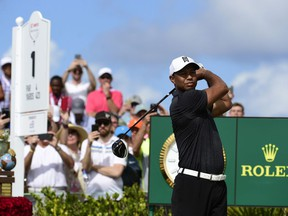 Tiger Woods tees off on the first hole at the Hero World Challenge golf tournament at Albany Golf Club in Nassau, Bahamas, Thursday, Nov. 30, 2017. (AP Photo/Dante Carrer)