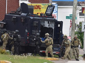 Three RCMP officers were killed and two injured by a gunman wearing military camouflage and wielding two guns in 2014.