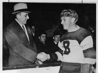 Ace Bailey (left) shakes hands with Bruins defenceman Eddie Shore at a benefit game for the injured Toronto Maple Leafs defenceman on Feb. 14, 1934.
