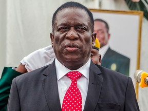 Zimbabwe's new President Emmerson Mnangagwa presides over a swearing in ceremony as his new cabinet took office on December 4, 2017 at State House in Harare.