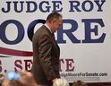 U.S. Senate candidate Roy Moore leaves the stage after giving a speech at the end of an election-night watch party.