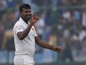 Sri Lanka's Lahiru Gamage gestures after dismissing India's captain Virat Kohli during the fourth day of their third test cricket match in New Delhi, India, Tuesday, Dec. 5, 2017.