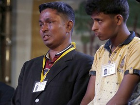 A Rohingya Muslim refugee, left, breaks down after meeting Pope Francis at an interfaith peace meeting in Dhaka, Bangladesh, Friday, Dec. 1, 2017. Pope Francis greeted and blessed Rohingya Muslim refugees who fled to Bangladesh from neighboring Myanmar, grasping their hands and listening to their stories at an interfaith peace prayer in Dhaka.