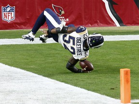 Los Angeles Rams inside linebacker Alec Ogletree (52) falls into the end zone after an interception for a touchdown against the Arizona Cardinals during the first half of an NFL football game, Sunday, Dec. 3, 2017, in Glendale, Ariz.