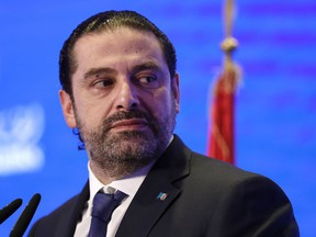 FILE - In this Nov. 23, 2017 file photo, Lebanese Prime Minister Saad Hariri speaks during a regional banking conference, in Beirut, Lebanon. Hariri formally rescinded his resignation following a consensus deal reached with rival political parties. The Tuesday, Dec. 5, 2017,  announcement came at the end of the first cabinet meeting to be held since Lebanon was thrown into a political crisis following Hariri's Nov. 4 surprise resignation from Saudi Arabia.