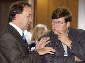 Quebec Justice Minister Marc Bellemarre (left) chats with Alberta Justice Minister David Hancock during a break at a meeting of federal, provincial and territorial justice ministers in La Malbaie, Que., Tuesday Sept. 30, 2003. Hancock has been named a provincial court judge.