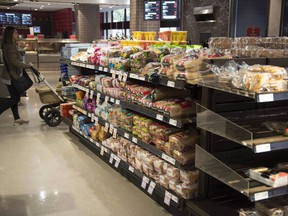 Various brands of bread sit on shelves in a grocery store in Toronto on Wednesday Nov. 1, 2017.