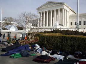 People sleep outside of the Supreme Court in order to save places in line for Dec. 5 arguments in 'Masterpiece Cakeshop v. Colorado Civil Rights Commission,' Monday, Dec. 4, 2017, outside of the Supreme Court in Washington.