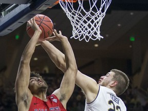 Notre Dame's Martinas Geben (23) blocks a shot by Ball State's Zach Gunn (15) during the first half of an NCAA college basketball game Tuesday, Dec. 5, 2017, in South Bend, Ind.