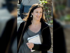 This April 4, 2016 file photo shows Maltese investigative journalist Daphne Caruana Galizia, who was killed by a car bomb in Malta on Oct. 16. On Monday, Dec. 4, 2017 Malta's prime minister Joseph Muscat announced the arrest of eight suspects, all Maltese citizens, in the murder of the journalist.