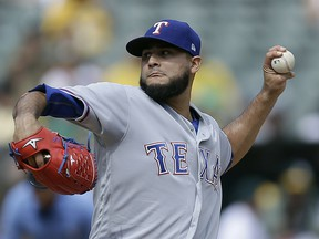 FILE - In this Sept. 24, 2017, file photo, Texas Rangers pitcher Martin Perez works against the Oakland Athletics in the first inning of a baseball game, in Oakland, Calif. Perez broke his non-pitching elbow in a mishap with a bull and is likely to miss the start of the season. Perez had surgery Monday in Dallas and is expected to start throwing in about a month. The Rangers said Tuesday, Dec. 19, 2017, the 26-year-old won't be ready for games for about four months, which could push his season debut into May. The injury occurred on Perez's ranch in his native Venezuela.
