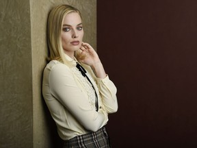 "FILE - In this Dec. 5, 2017 photo, Margot Robbie, a cast member in ""I, Tonya,"" poses for a portrait in Los Angeles. Robbie says she really wants to tie on skates and get back on the ice over the Christmas holiday. She learned to ice skate for her role as figure skater Tonya Harding but her contracts on three other films have prevented her from getting back on the blades."