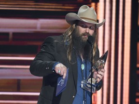 """FILE - In a Wednesday, Nov. 8, 2017 file photo, Chris Stapleton accepts the award for album of the year """"From A Room: Volume 1"""" at the 51st annual CMA Awards at the Bridgestone Arena, in Nashville, Tenn."""