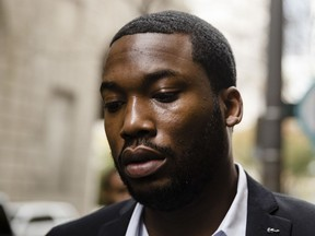 In this Nov. 6, 2017 photo, rapper Meek Mill arrives at the criminal justice center in Philadelphia. Common Pleas Judge Genece Brinkley on Friday, Dec. 1, 2017 denied a motion allow the 30-year-old rapper to be bailed out of a Pennsylvania correctional facility. Mill was sentenced last month to two to four years for violating probation on a roughly decade-old gun and drug case.