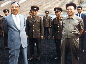 A photo taken in 1992 shows Kim Jong-Il, right, and then-leader, Jong-il's father, Kim Il-Sung.