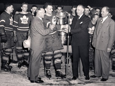 Ted Kennedy (centre) accepts the Stanley Cup from NHL president Clarence Campbell on April 16, 1949.