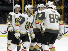 Vegas Golden Knights center William Karlsson (71), of Sweden, celebrates with teammates after scoring a goal against the Nashville Predators during the first period of an NHL hockey game Friday, Dec. 8, 2017, in Nashville, Tenn.