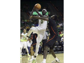 Baylor forward Jo Lual-Acuil Jr. (0) drives against Sam Houston State forward Chidozie Ndu during the first half of an NCAA college basketball game in Waco, Texas, Monday, Dec. 4, 2017.
