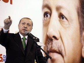 Turkey's President Recep Tayyip Erdogan gestures as he delivers a speech to supporters of his ruling Justice and Development Party, AKP, during a rally in Agri, eastern Turkey, Sunday, Dec. 3, 2017.