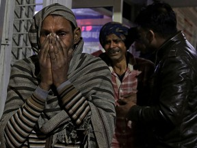 Relatives of firecracker factory fire victim, wail at a hospital on the outskirts of New Delhi, India, early Sunday, Jan. 21, 2018. A big fire broke out at a firecrackers factory on the northern outskirts of the Indian capital on Saturday, killing at least 17 workers, a fire official said.