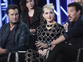 """Luke Bryan, from left, Katy Perry and Lionel Richie participate in the """"American Idol"""" panel during the Disney/ABC Television Critics Association Winter Press Tour on Monday, Jan. 8, 2018, in Pasadena, Calif."""